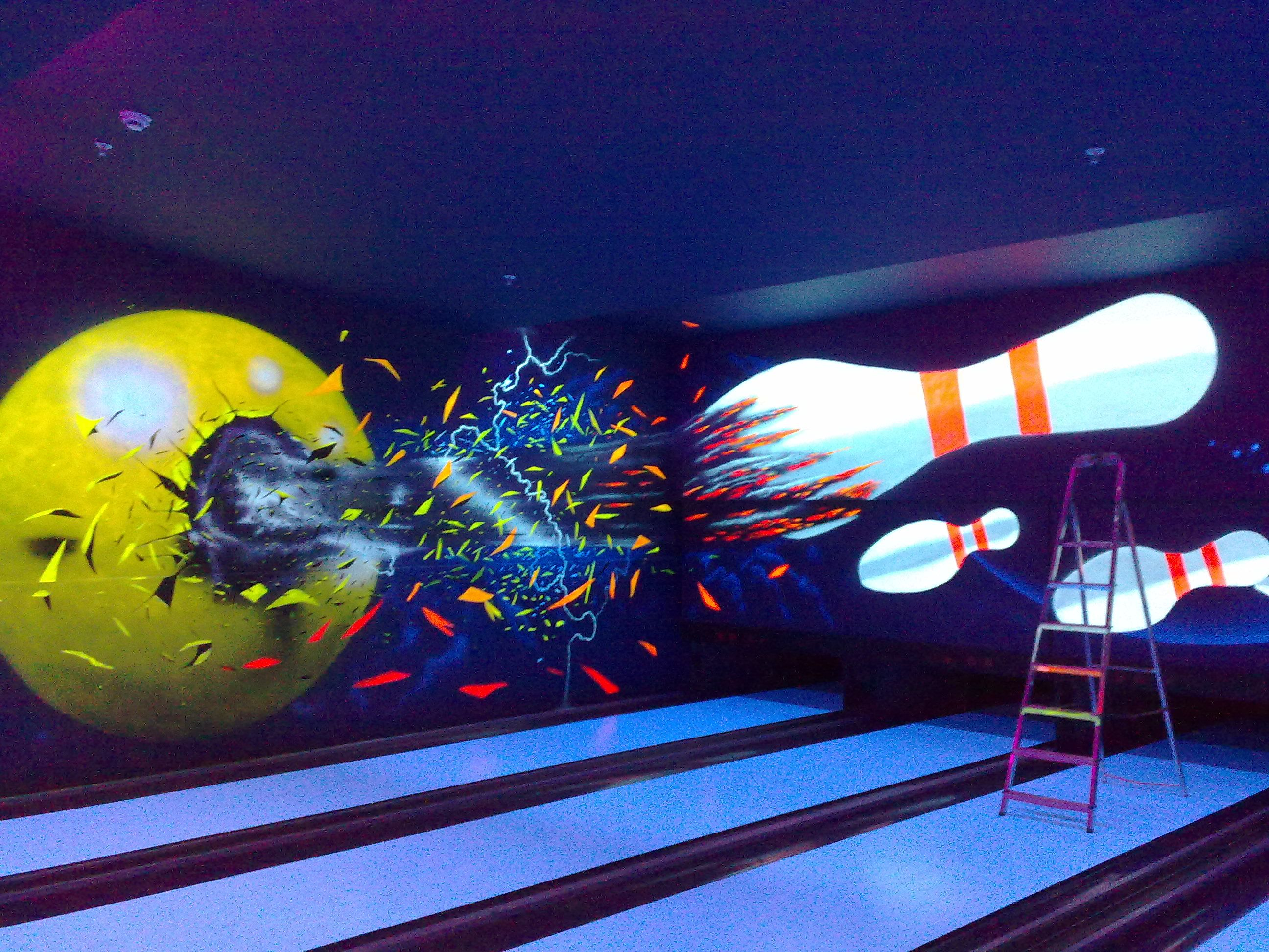 uv themed bowling alleys incorporate uv fluorescent paints and
