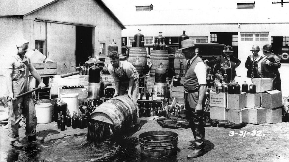 From 1919 to 1933, the United States was a dry nation. It was illegal to make, sell, or consume alcohol. In this collection of images, you'll see what daily life was like in a country where police poured millions of gallons of booze into the gutters -- and everyone else surreptitiously drank it in bizarre, hidden places.