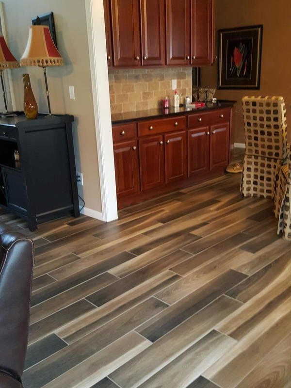 Wood-Look Tile is one of our hottest new flooring styles – perfect for high-moisture areas of the home! Here's Brindle Wood Tobacco in a customer home.