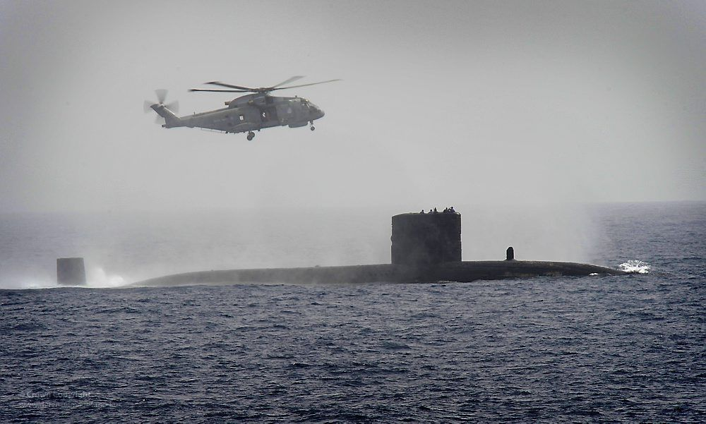 Royal Navy Submarine HMS Turbulent with a Merlin Helicopter from HMS ...