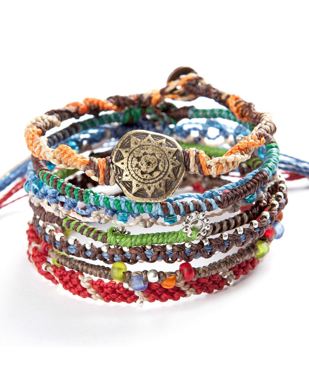 Set of 7 colorful bracelets hand woven by women in Guatemala tells the story of the earth. Fair trade and ethically produced.