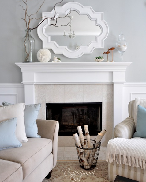 Chic Living Room Design With Gray Walls Paint Color, Casbah Mirror Painted  White, Fireplace, Tan Sofa, Blue Pillows And Wainscoting.