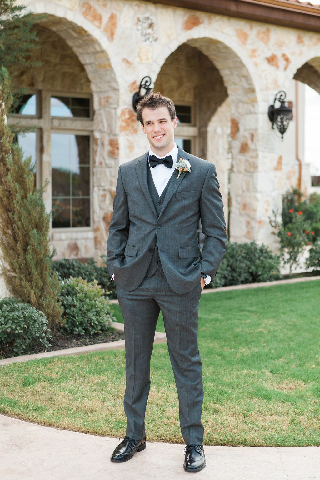 Such a handsome groom in charcoal gray! Love his gray suit and ...