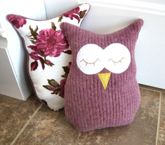 This friendly little owl pillow or owl plush is made from recycled wool sweaters and backed with a beautiful flower dress fabric. Its sure to make anybody happy with glee!    Just the right size for little hands, or perfect to adore that plain looking couch. This feathered friend stands 10 tall and 8 wide. Hand made with love in my smoke free home studio, the front is 100% wool, the back is poly dress fabric, and is stuffed with polyester fiber fill.    Copyright © 2011 Pink Bunny Patterns…
