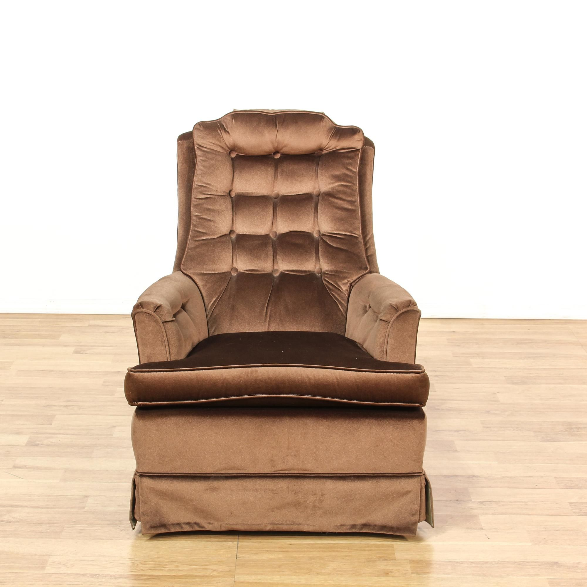 This armchair is upholstered in a durable velour with a chocolate