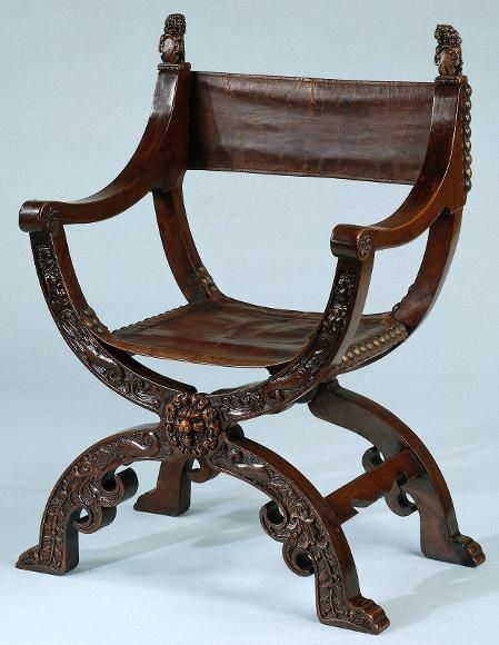 lady morgaine looks regal in her roman chair. the armrests have