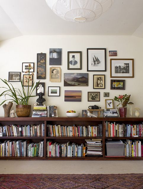 Floating bookshelves, a gallery wall and eclectic decorative items.