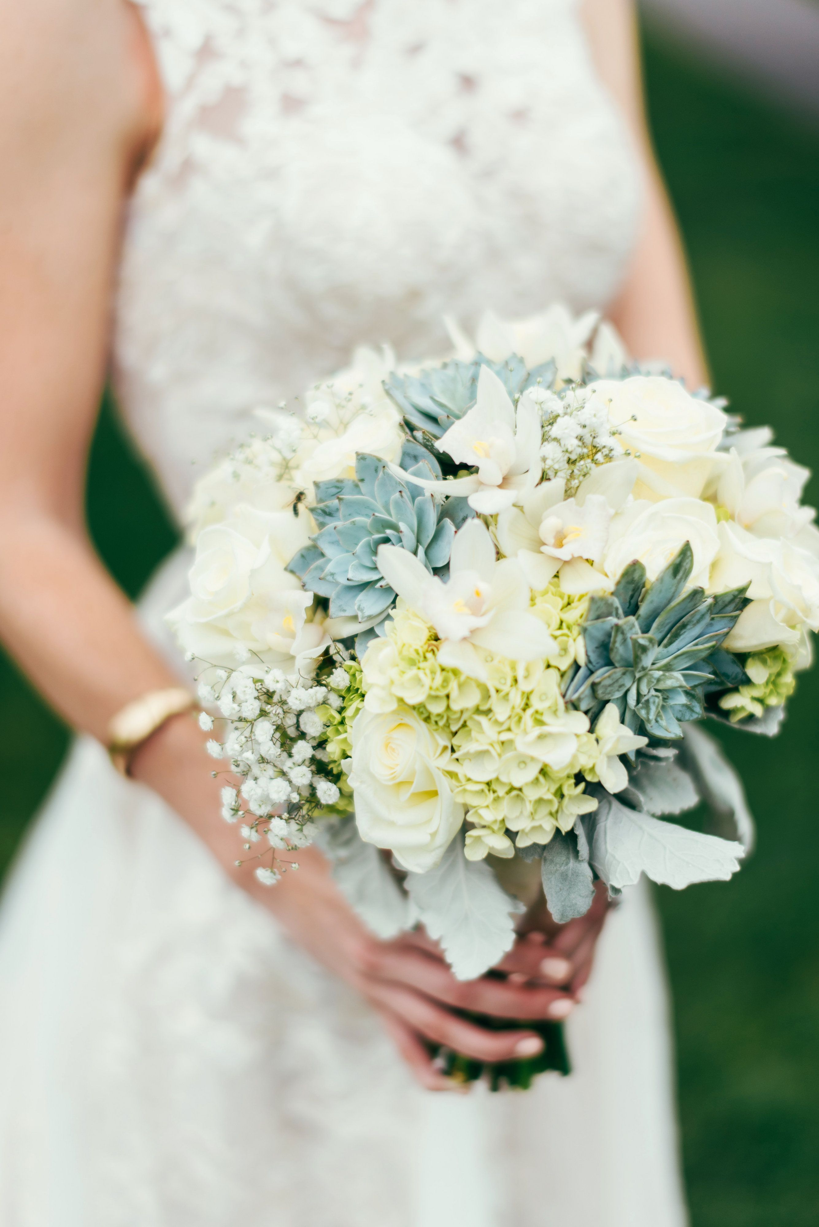 bouquet with succulents, hydrangeas, polo roses, and baby