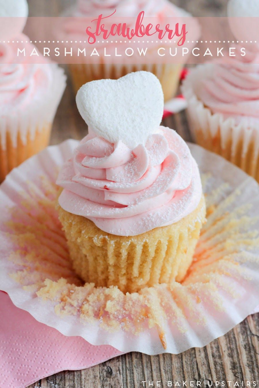 Strawberry marshmallow cupcakes - vanilla cupcakes filled with marshmallow cream and topped with a sweet strawberry marshmallow buttercream. Yum! www.thebakerupstairs.com
