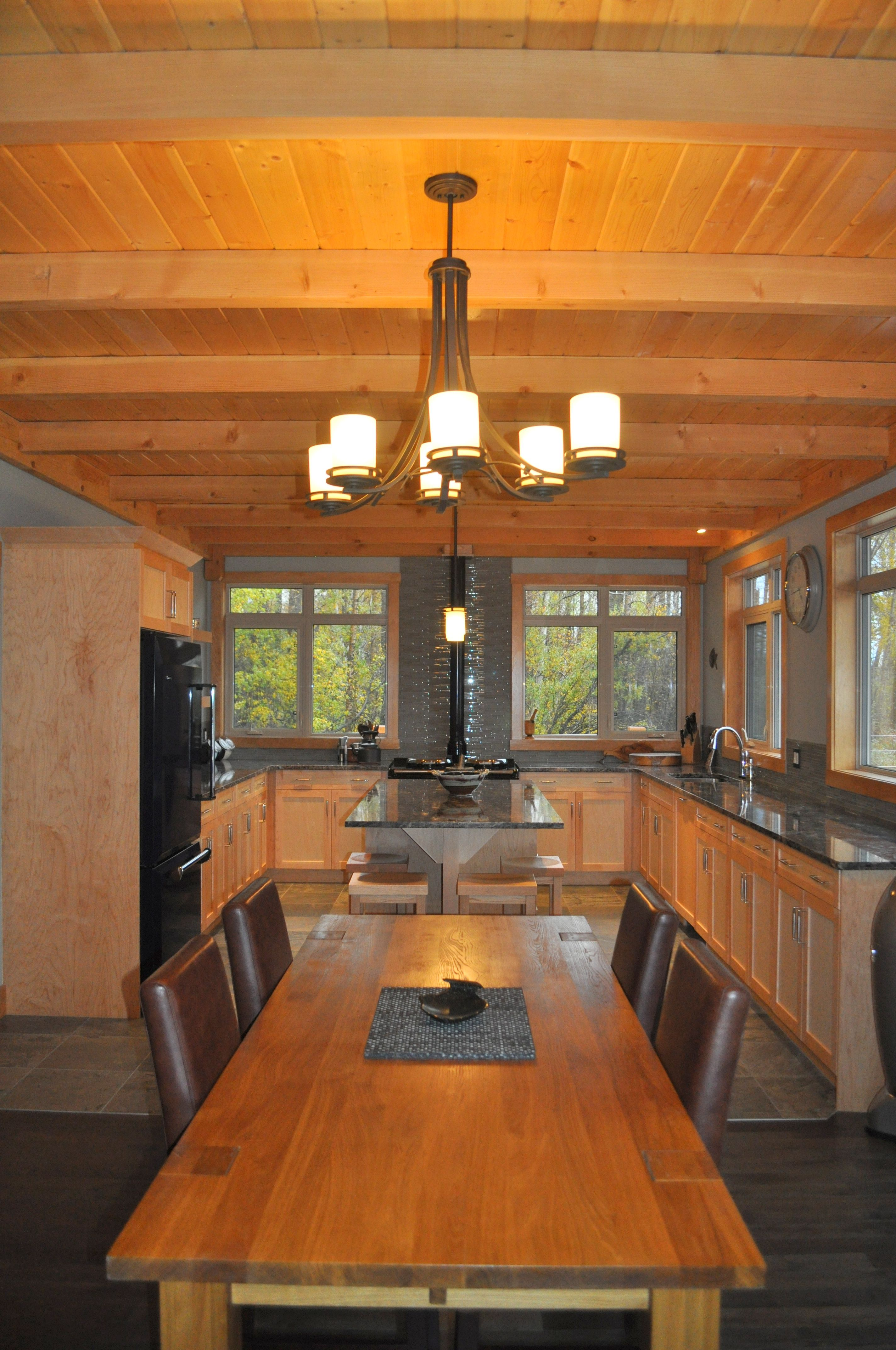 Designer kitchen dining room is featured in a custom timber