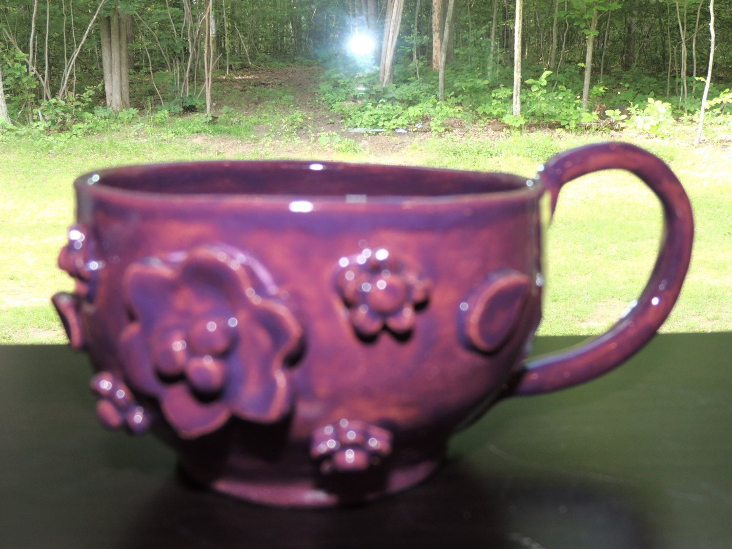 One of a kind hand thrown coffee cup.  Has flowers added for a raised dimension, purple glaze finish. Hand wash, food safe. by GabiLuBoutique on Etsy
