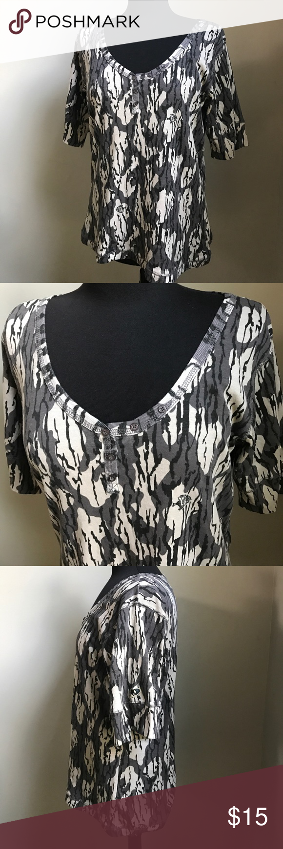 Mossy Oak Elbow Length Women's Camo Top - XL Ready for the outdoors, this top from Mossy Oak has elbow length sleeves and a rounded neck with little button detailing. This top has a camo pattern in grey and black. This size XL top is ready to ship from a non smoking home. Mossy Oak Tops Tees - Short Sleeve