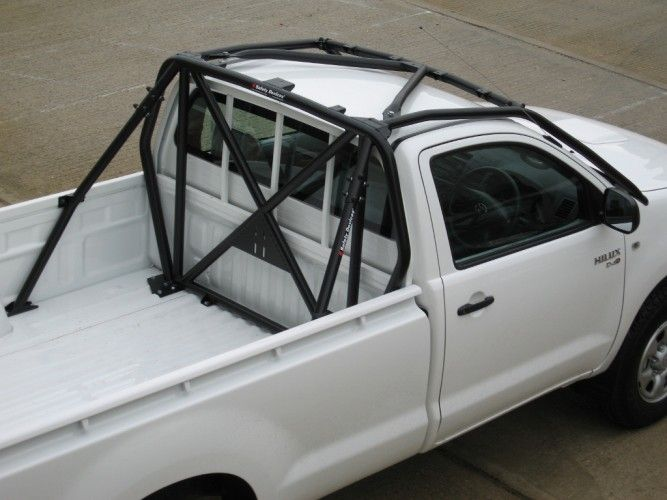 Roll cage toyota pickup dodge off road vehicles pinterest toyota for Interior roll cage for toyota pickup