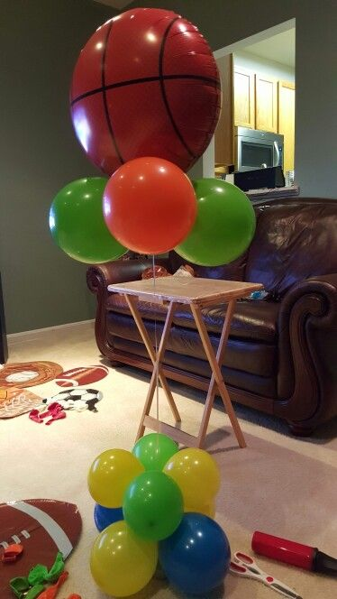 Balloon table centerpiece Sports theme baby shower Pinterest