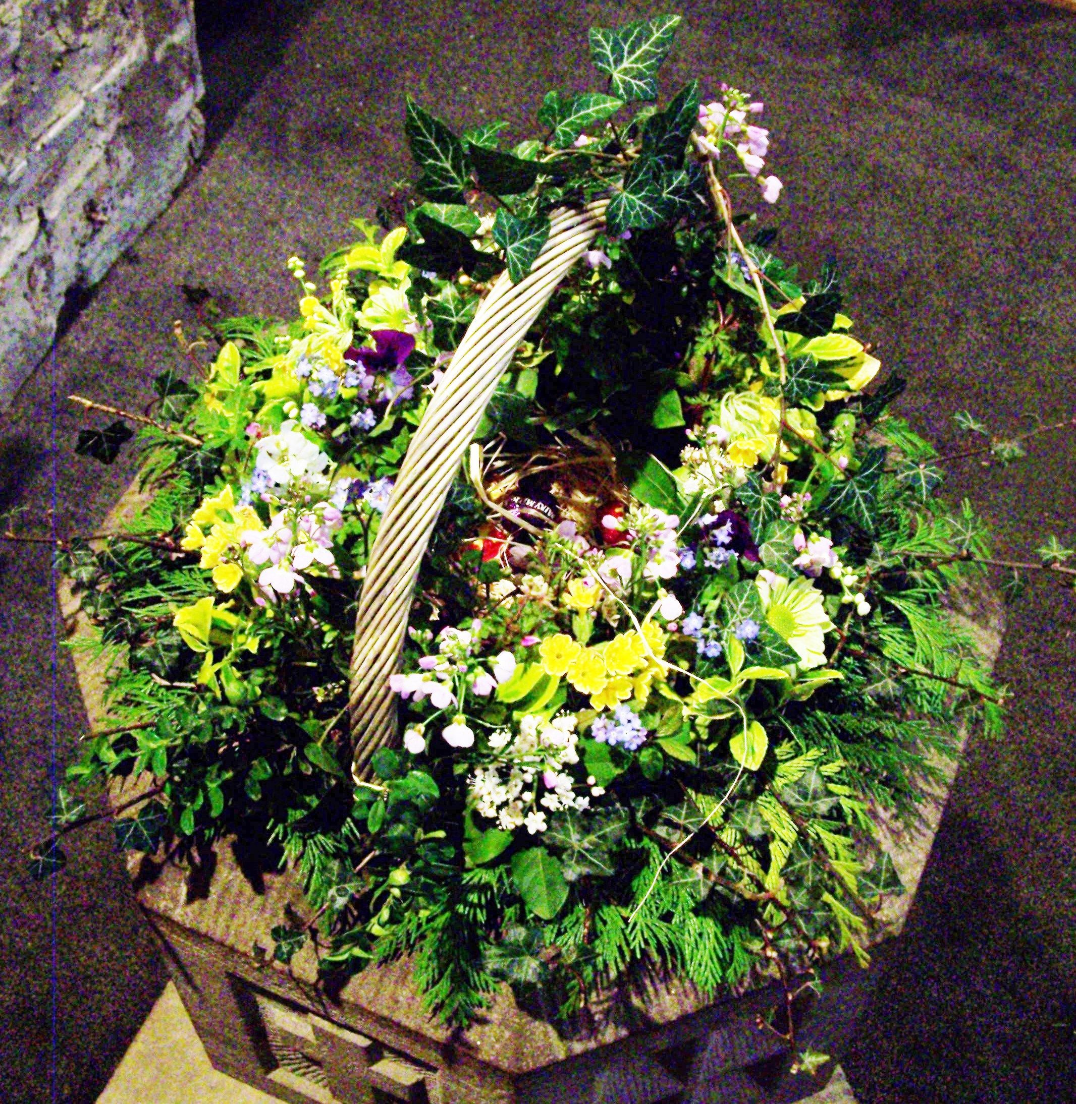 St Giles, Ludford, Easter 2012 - in the font: a nest of wildflowers containing Easter eggs for the children.
