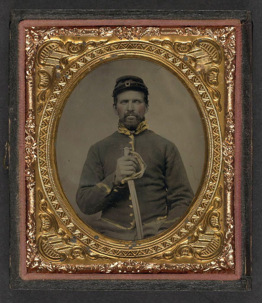 (c. 1861-1865) Soldier in Union cavalry uniform holding cavalry saber