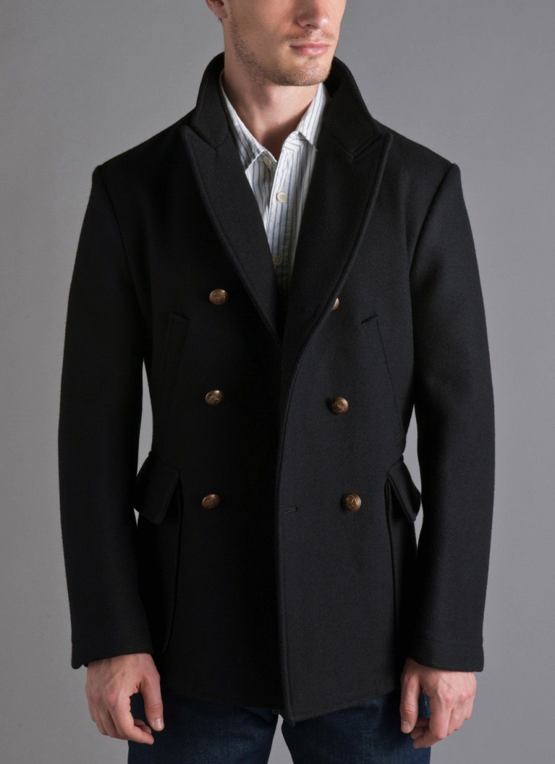 592757773fd James Bond s peacoat from Skyfall. Peak lapels. Functioning cuffs. Brass  buttons. Some serious leather stitching under the collar. Licence to kill.