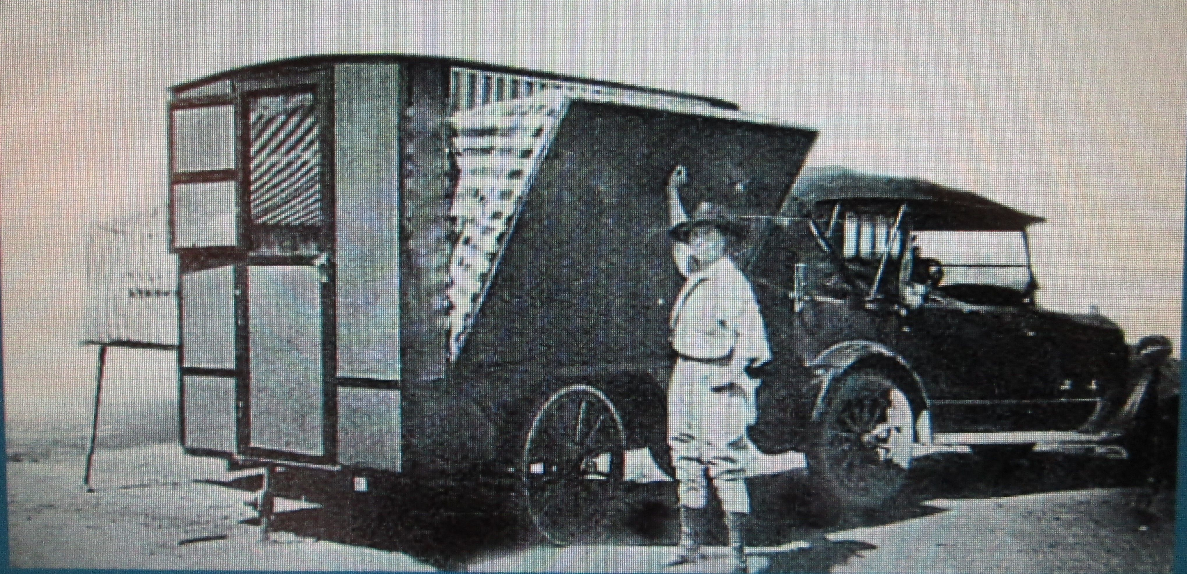1920's model T Ford touring car with fold out side camper.