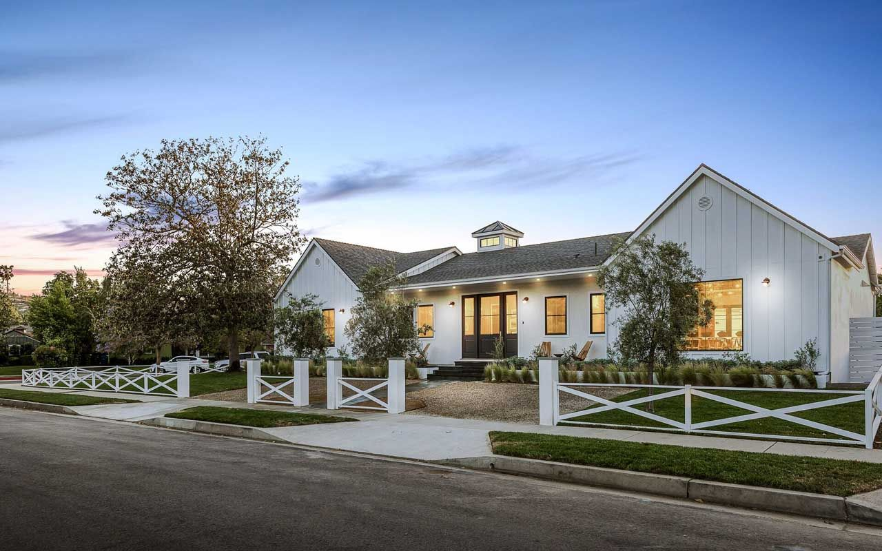 Exterior home design one story  This grand singlestory farmhouse sitting on a spacious lot has it