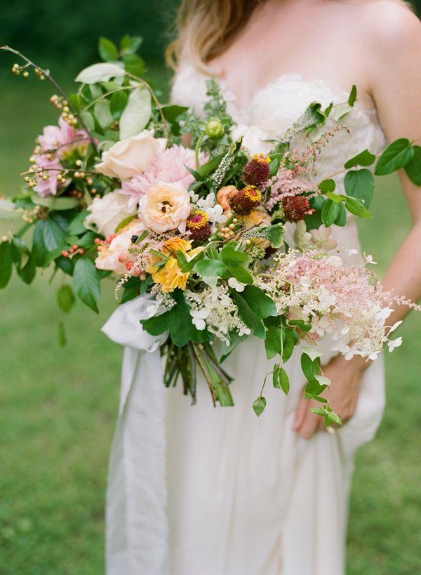 organic peach toned bouquet, photo by Faith Teasley http://ruffledblog.com/bloomsbury-farm-wedding-inspiration #weddingbouquet #flowers