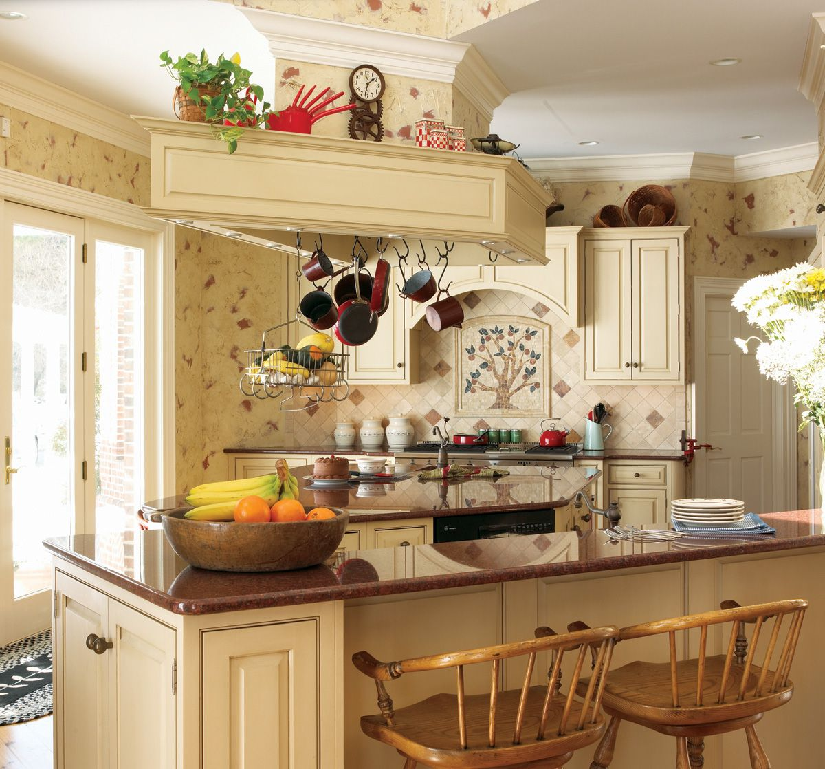 French country kitchens - This French Country Kitchen Features Soft And Pleasant Tones To Accentuate The Ample Natural Sunlight That