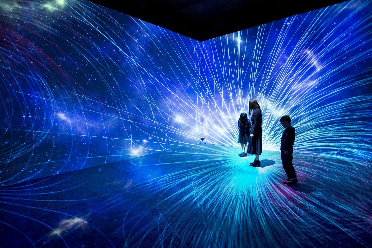 Play in the aurora borealis at a room sized interactive for Outer space stage design