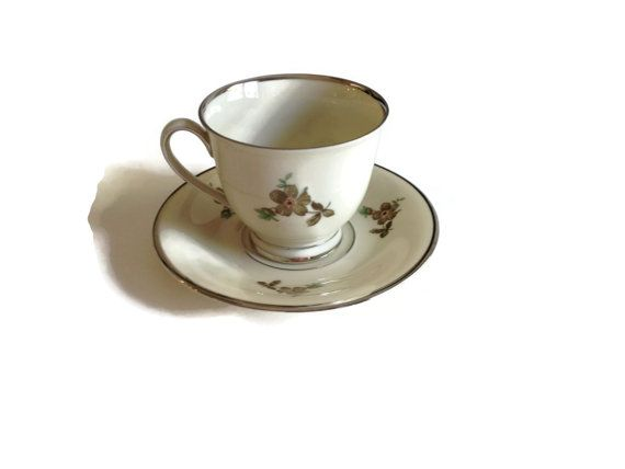 Tea Cup and Saucer by Kjobenhavns Porcellains Maleri KPM Denmark Footed Porcelain Platinum Trim  This lovely tea cup and saucer in the Green