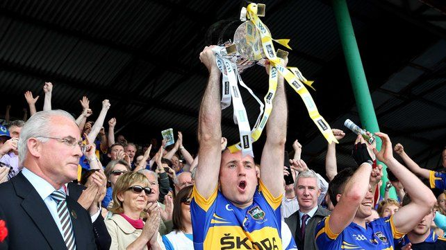 Tipperary's Eoin Kelly raises the Munster trophy aloft after their drubbing of Waterford in the 2011 decider