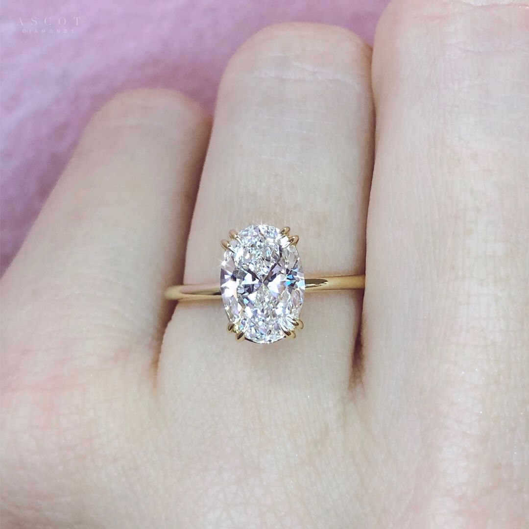 The magnificent beauty of this oval cut natural diamond engagement ring is the result of our high standards and passion to create the most beautiful diamond rings.  Design your engagement ring with Ascot Diamonds.    #engagementrings #ovalcut #diamondrings #solitaireengagementrings #ascotdiamonds