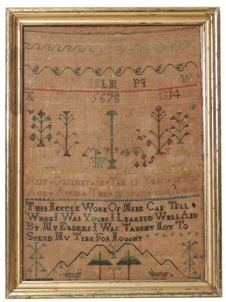 1767 MARY GARDNER NANTUCKET SAMPLER, silk on linen worked in black, yellow, greens, red, brown and white; there are two goats, two sheep and a dog, potted plants, stylized trees, set apart by two rows of sawtooth pattern is the legend Mary Gardner in the 15 Year of Her Age. April the 10 1767; followed by      This Needle Work of Mine Can Tell, When I was Young I Learned Well And, By My Elders I was Taught Not To, Spend My Time for Nought.  15.25 in. x 11 in.