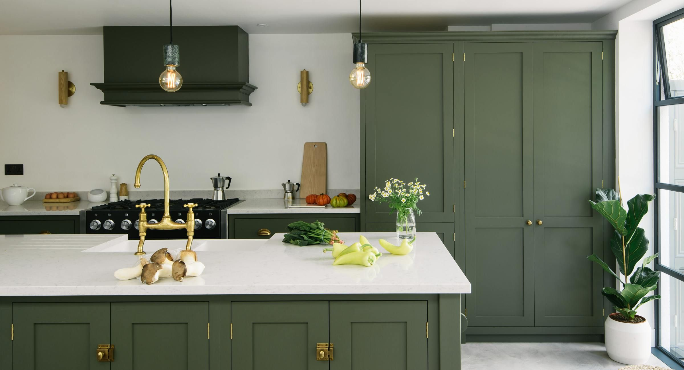 Brass Gold Handles Green Cabinets Big Window At End Of Kitchen Gray Floors White Counte Green Kitchen Interior Kitchen Color Trends Interior Design Kitchen