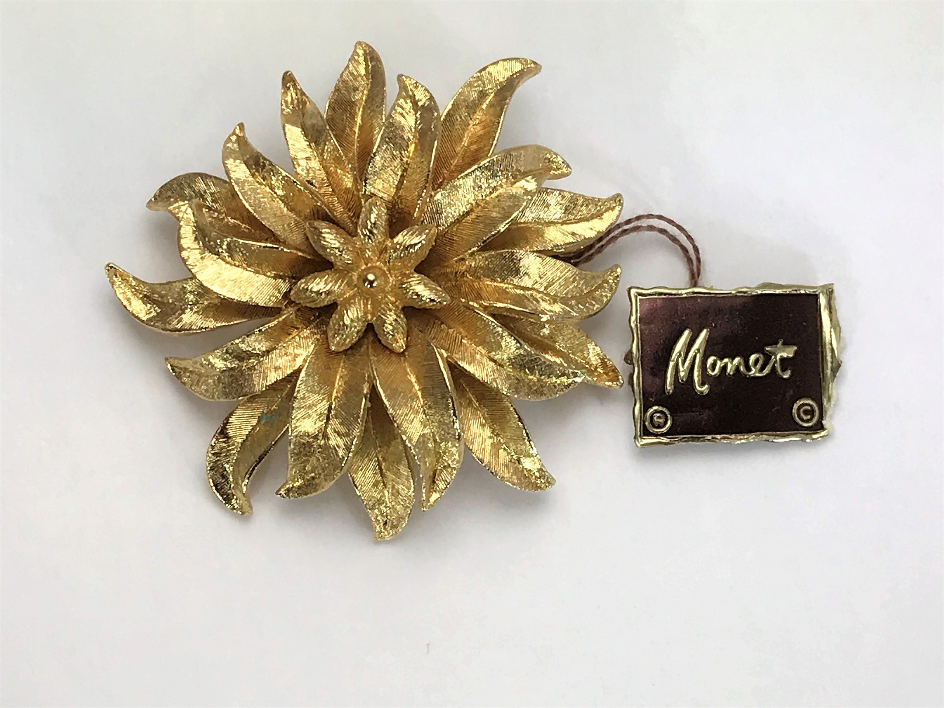1a2c6c0f8 Beautiful Vintage MONET Margo Gold Tone Flower Brooch 1960's with Original  Tag by LoubooluJewellery on Etsy