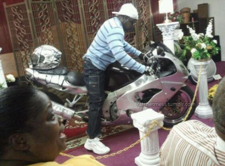 A Young dead black man at funeral home on his motorbike