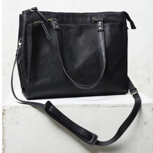"""Free People Beaumont Vegan Tote in Black Sold out, gorgeous tote. Carried < 5x. Perfect condition aside from 3 of the 4 corners being peeled a bit and one of the top corners, shown. Purchased this way, and not noticeable at all. Very Madewell-esque. """"Multifunctional structured vegan leather tote featuring tons of pockets and compartments. Removable and adjustable long strap. Zip top closures. Measurements: Dimensions in Inches: 15 1/2 x 12 x 5 1/4"""" Free People Bags Totes"""