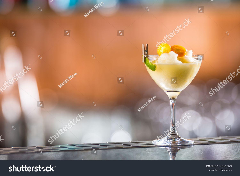 Cocktail drink frozen margarita at barcounter in night club or restaurant. ,