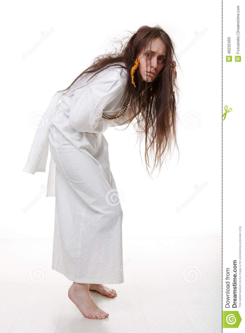 portrait of a crazy woman in a straitjacket stock photo image