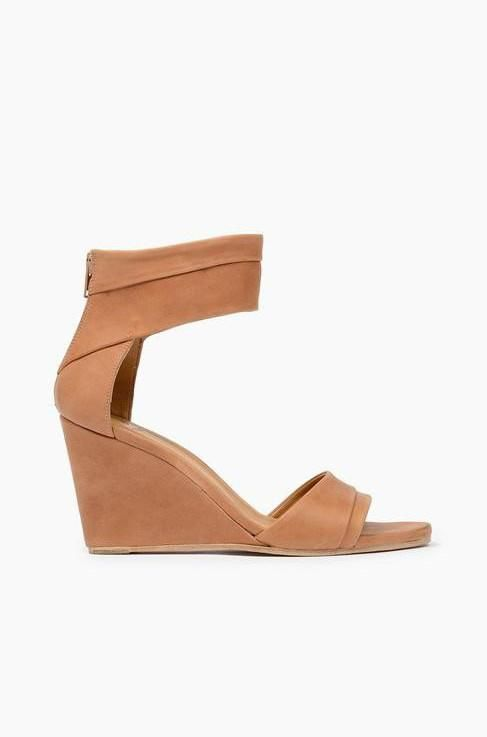 1ccc1db758c7 Wedge sandals from Coclico. Features ankle cuff. Exposed back zip. Leather  lined. Covered wedge heel with rubber cap. Leather sole.