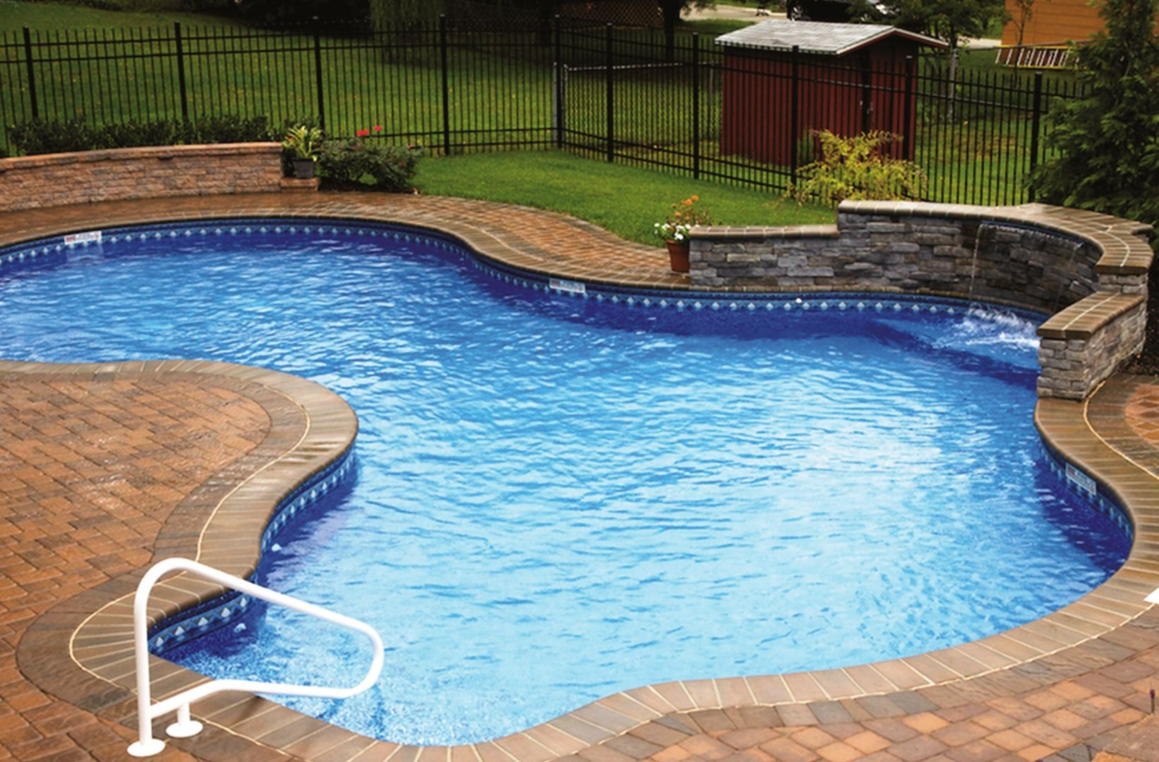 Pool Paver Ideas pool deck by unilock with richcliff paver and steps Back Yard Swimming Pool Ideas