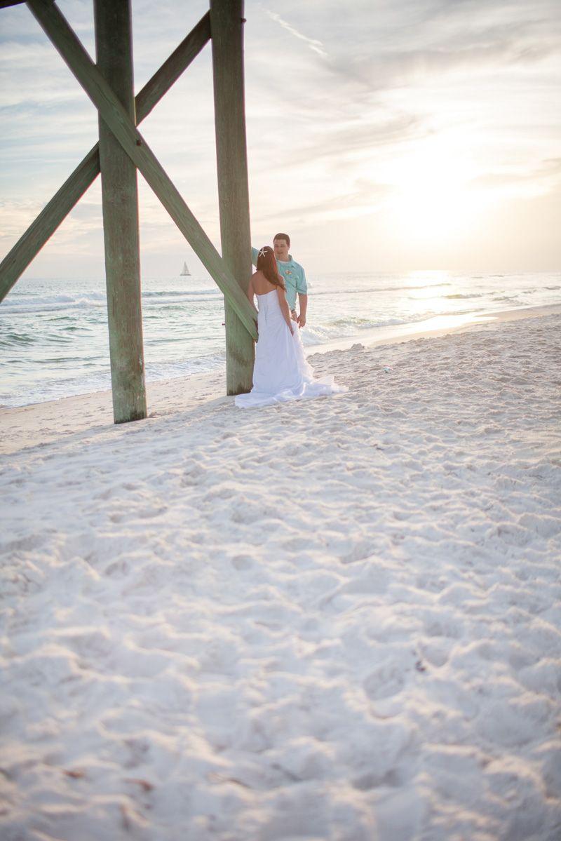 A quiet moment after their beach wedding beautiful wedding