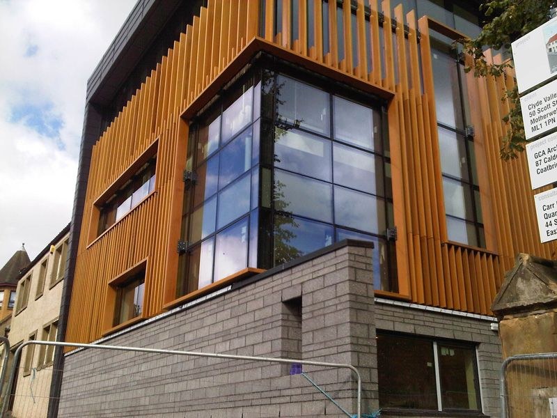 Western Red Cedar Factory Coated Brise Soleil Brick Facade