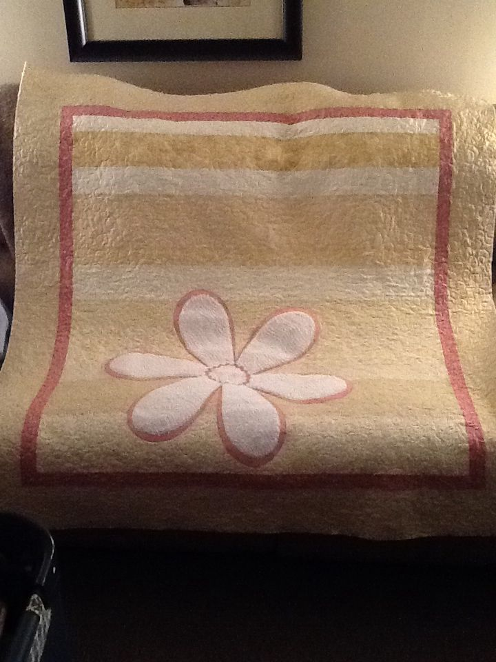 Jelly Roll Quilt with Chenille flower