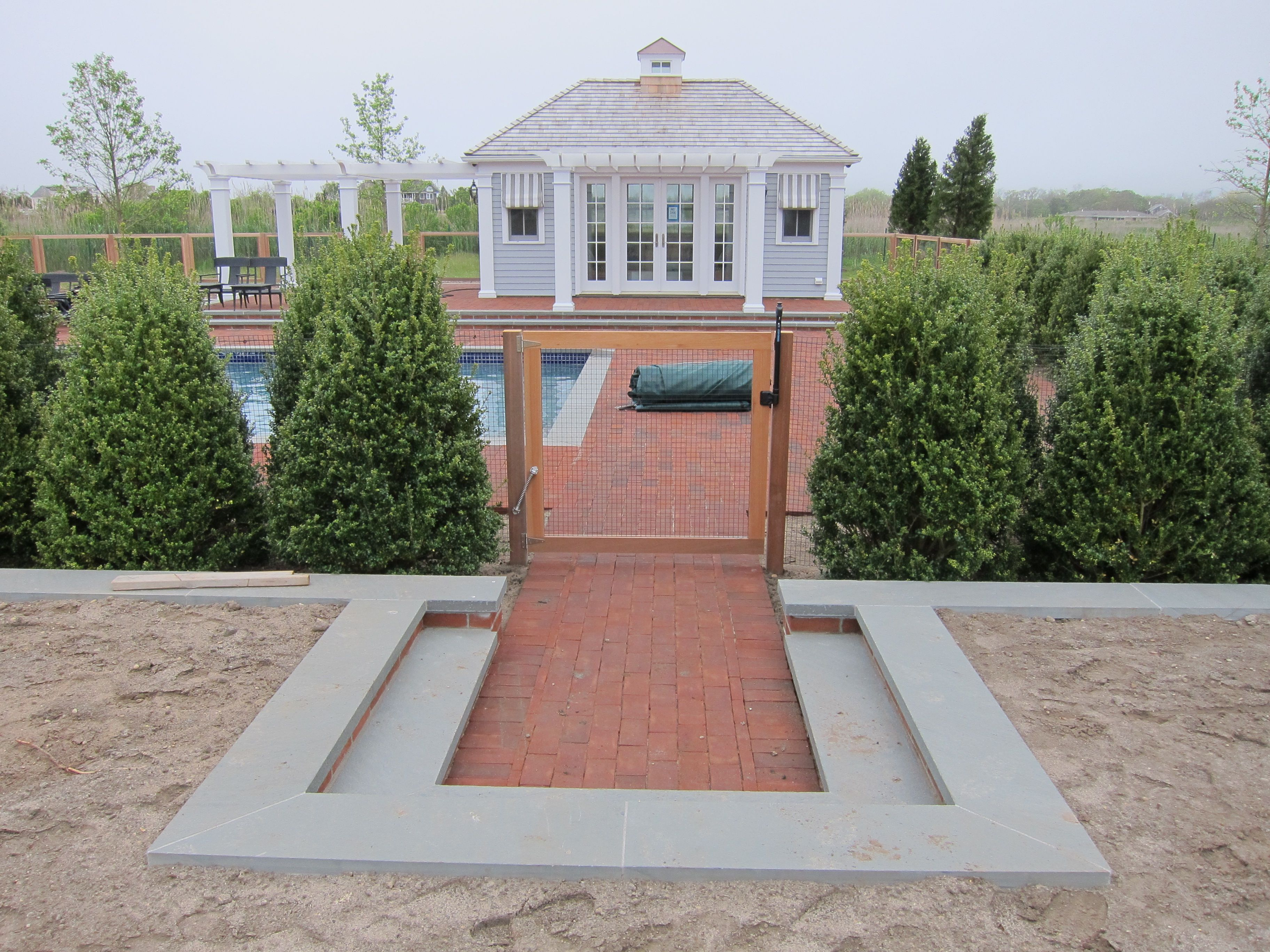 Stone Patio With Steps And Pool Entrance Gate