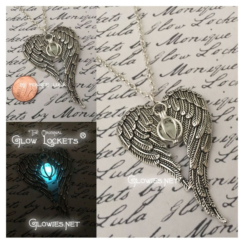 Two ornate and vintage style angel wings drape in a heart shape around one of my Orb Glow Lockets ® to create a magical necklace unlike any other, and these are in my limited edition collection so the