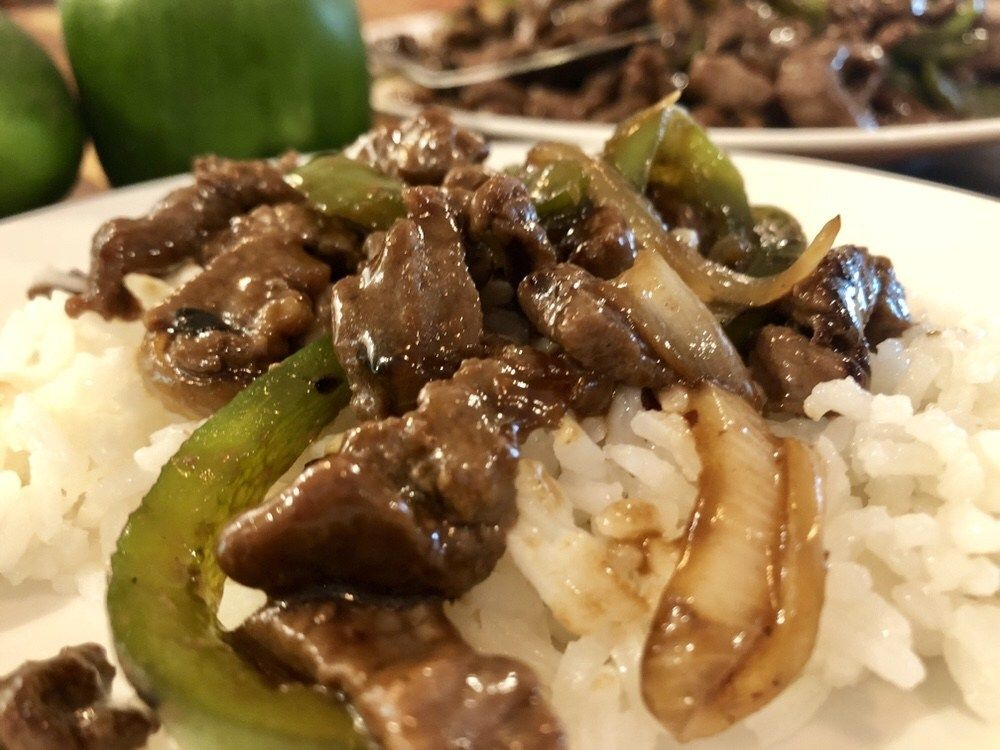 pepper steak is a tasty asian style dish served on a bed of white rice recipe pepper steak stuffed peppers steak and mushrooms pinterest