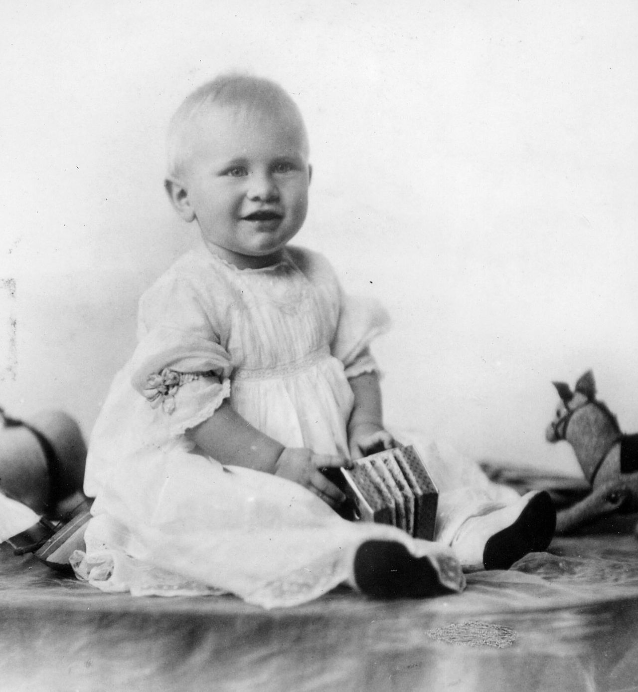 Until around the 1940s, it was common for baby boys to be outfitted in dresses. Above is a picture of Gerald Ford as a ten month old in one such dress. FDR was also outfitted similarly, at an even older age, as seen here.