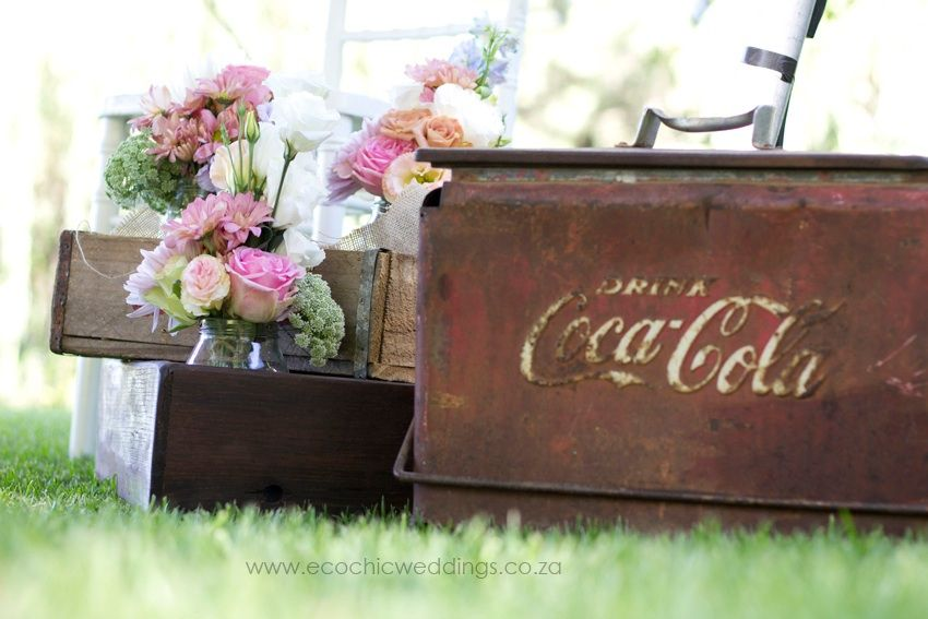 Old school coca cola cooler box as decorative piece next to coca cola crates…