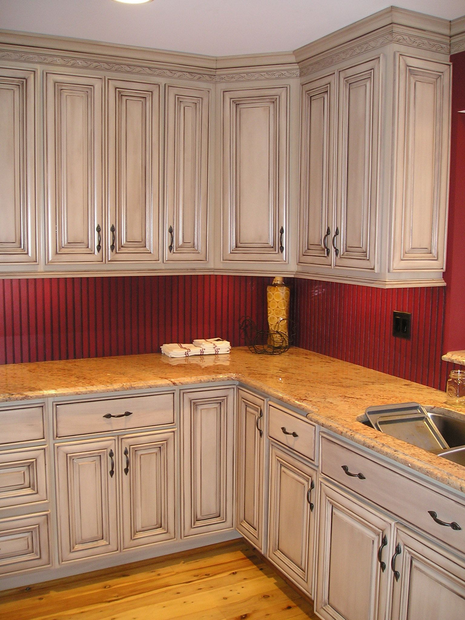 taupe with brown glazed kitchen cabinets and red glazed ...
