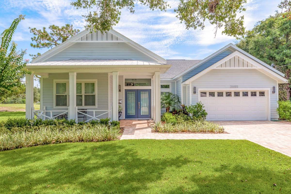 An attractive gabled front porch with a matching gabled garage give