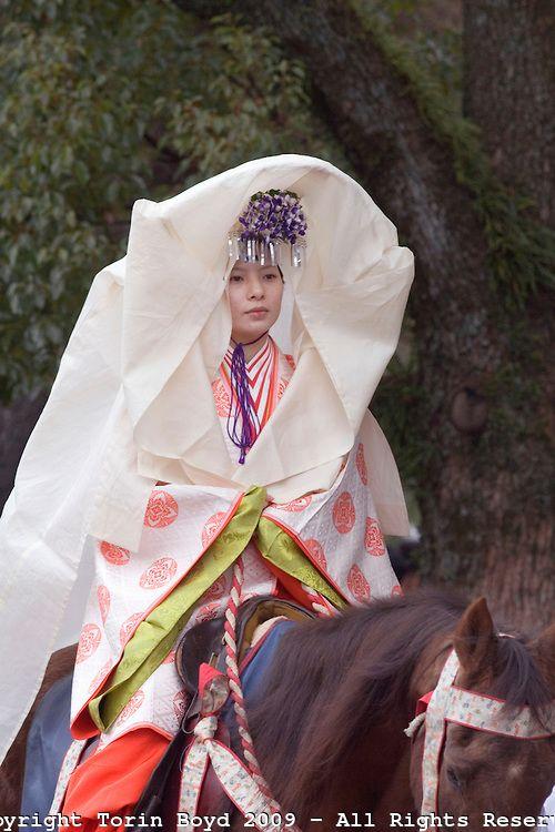 on matsuri festival. A woman dressed in junihitoe.