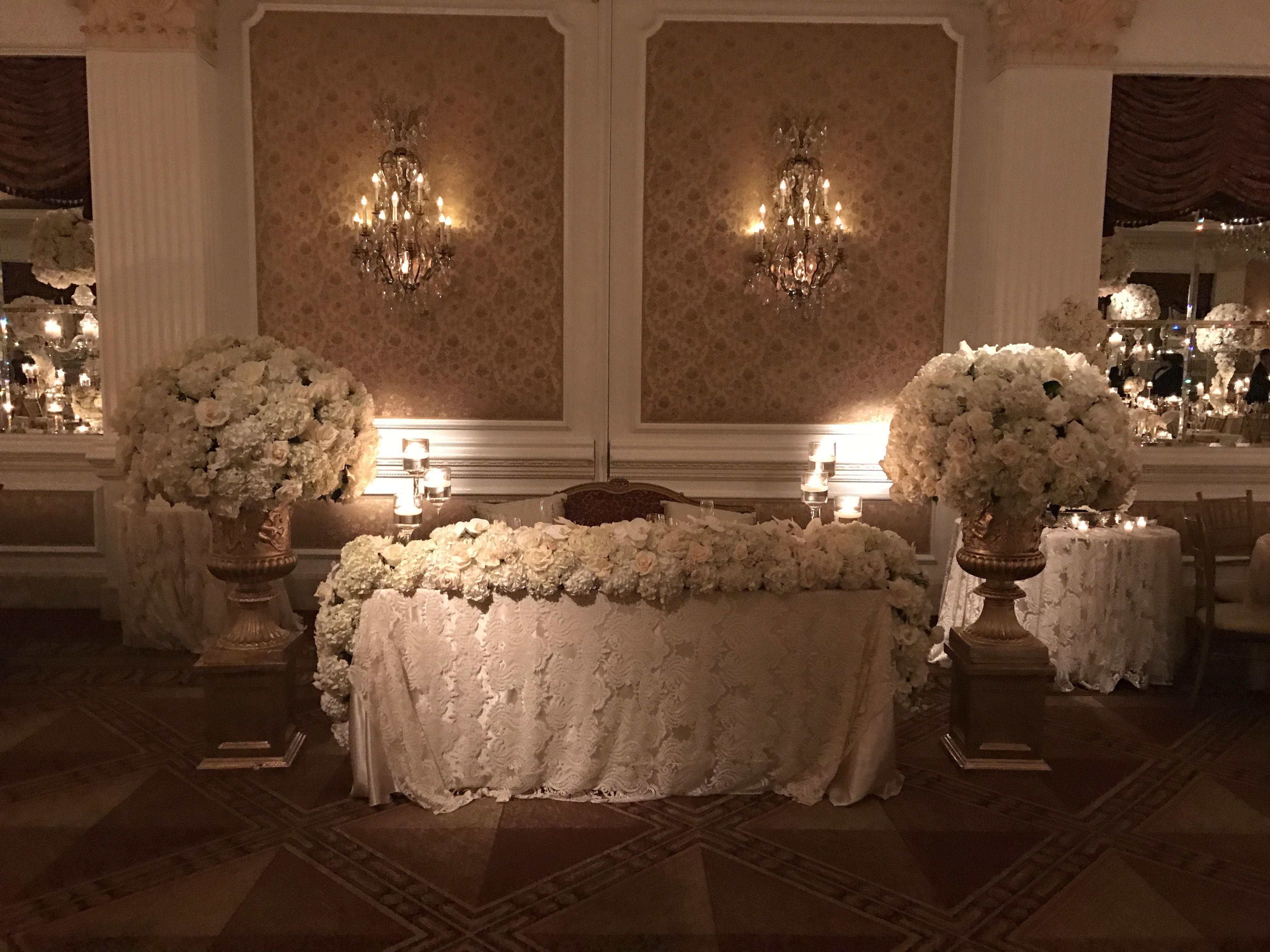 Orange traditional wedding decor  This very traditional style sweetheart table looked amazing at the